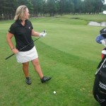 Leighann Albaugh, PGA about to hit a golf chip shot during short game practice at The Hollows Golf Club in Richmond Virginia